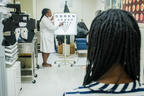 image tagged with exam, vision exam, african-american, check-up, vision, …;