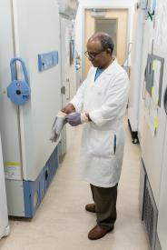 image tagged with fridge, hallway, glasses, indian, lab coat, …;