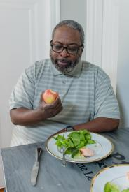 image tagged with table, middle aged, african-american, apple, sit, …;
